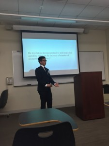 Kai Tay presents his paper on occupational safety regulations at the IHS Student Research Workshop.