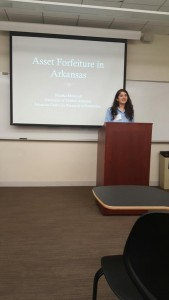 Maleka Momand giving a presentation at the IHS Student Research Workshop.