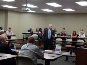 Mr. Wes Kemp, former president & CEO of ABF Freight System, speaks with UCA students, faculty & staff
