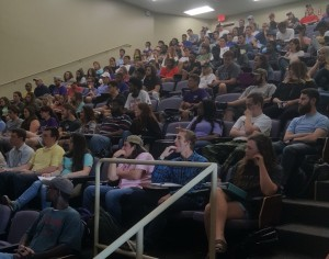 Students listen to a lecture from Dr. Jason Brennan on the ethics of voting.