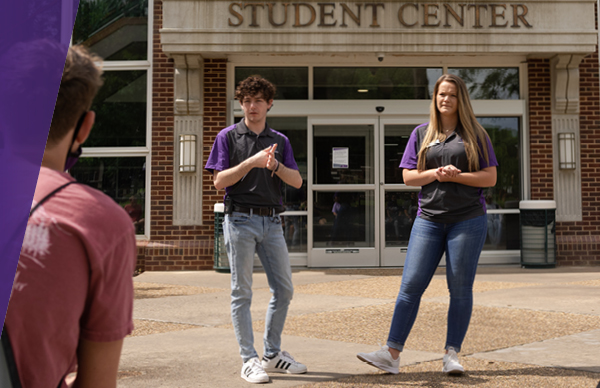 Students giving campus tour in front of Student Center