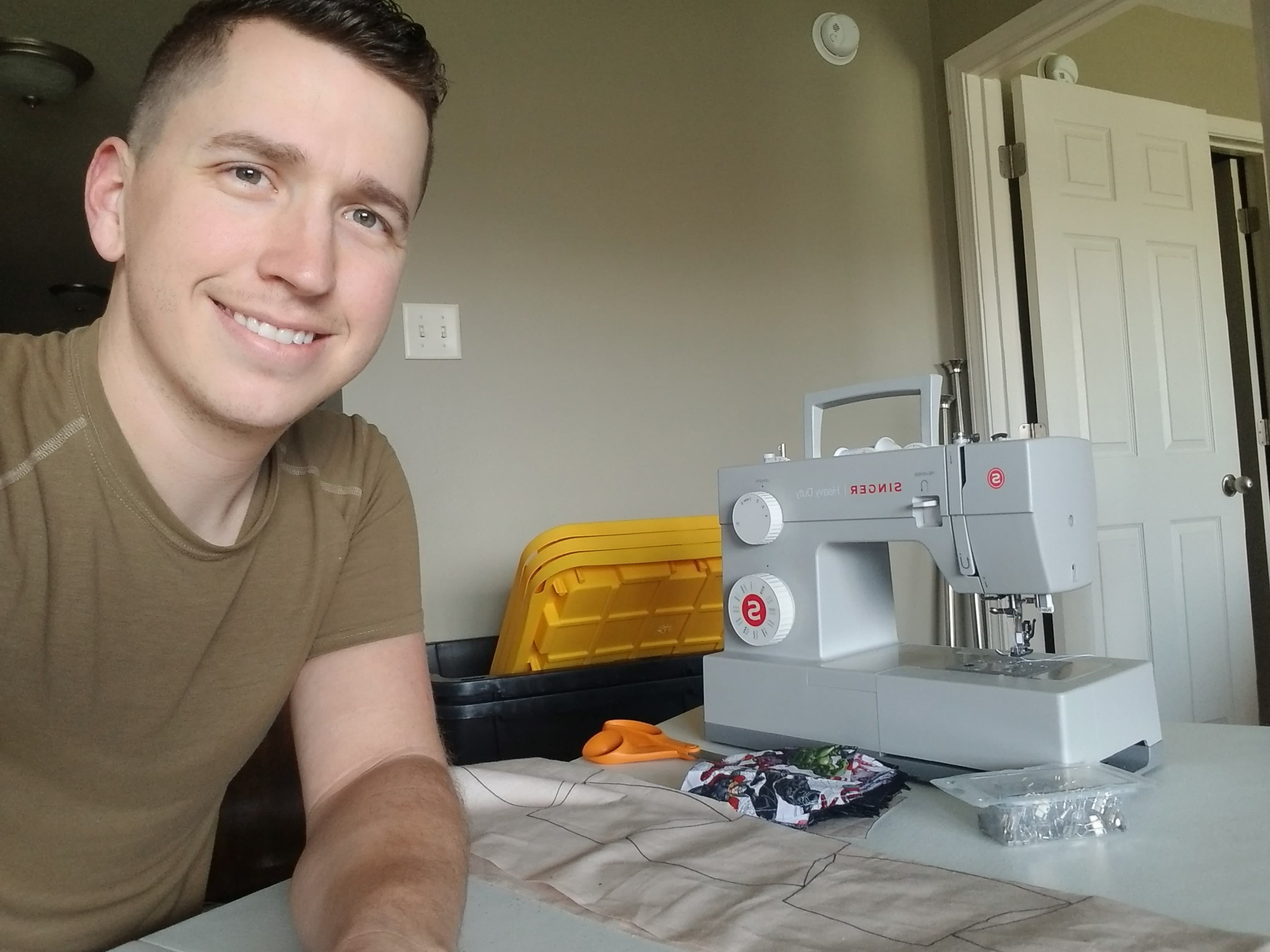 Christopher James with sewing machine