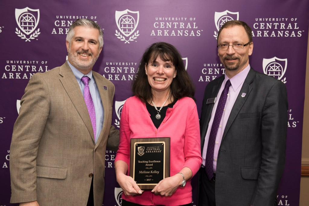 President Houston Davis; Dr. Melissa Kelley, Department of Chemistry, 2017 Teaching Excellence Award recipient; and Dr. Steve Runge, executive vice president and provost