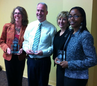 Award winners pose with their professor. (L-R) Dr. Hunter Phillips Goodman, Timothy Bullington, associate professor Dr. Rhonda McClellan, and Mariama Laouali Balla.