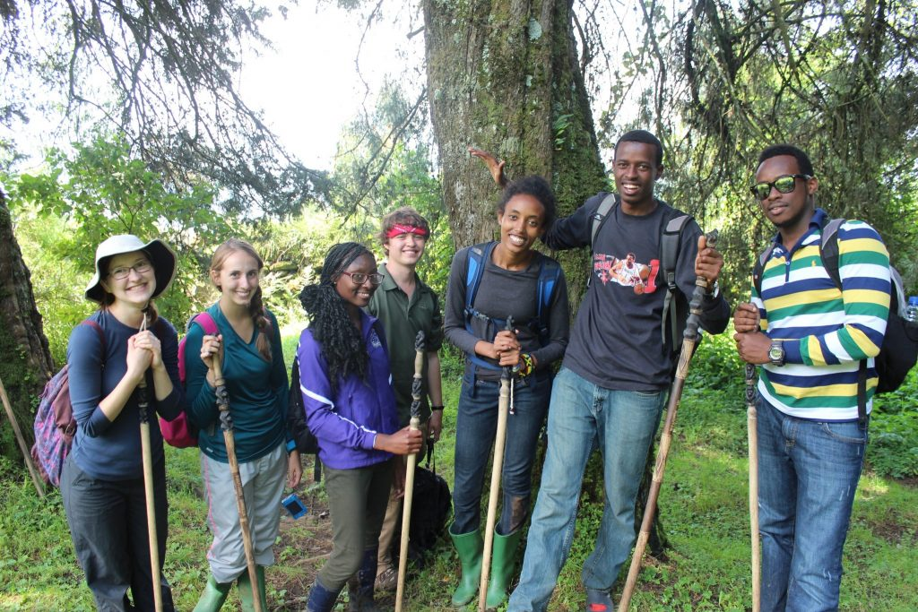 UCA students pictured posed with walking sticks while Gorilla Trekking during a Study Abroad Trip