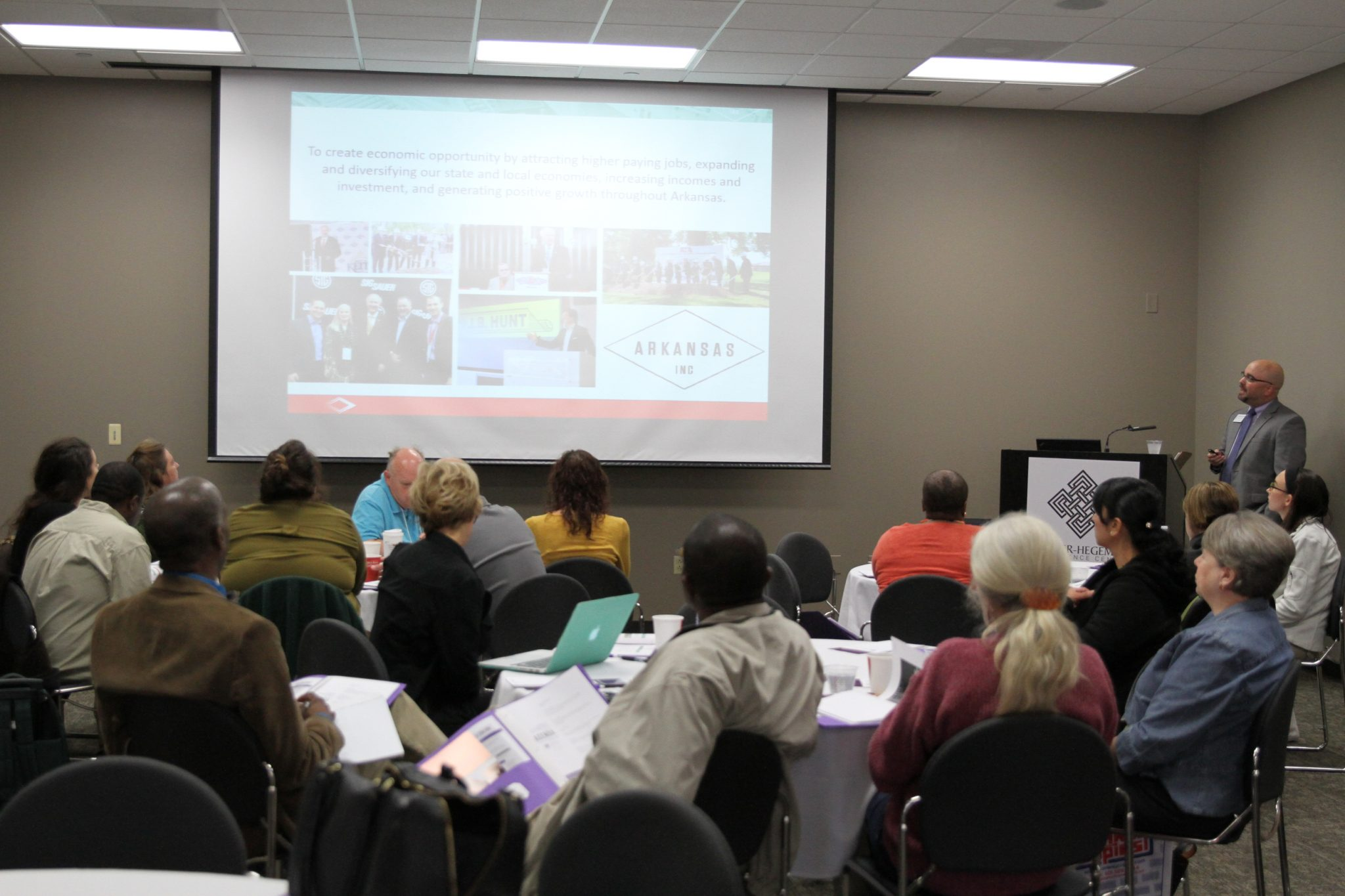 CDI participants listen to a presentation given by Matt Twyford of the Arkansas Economic Development Commission (AEDC).