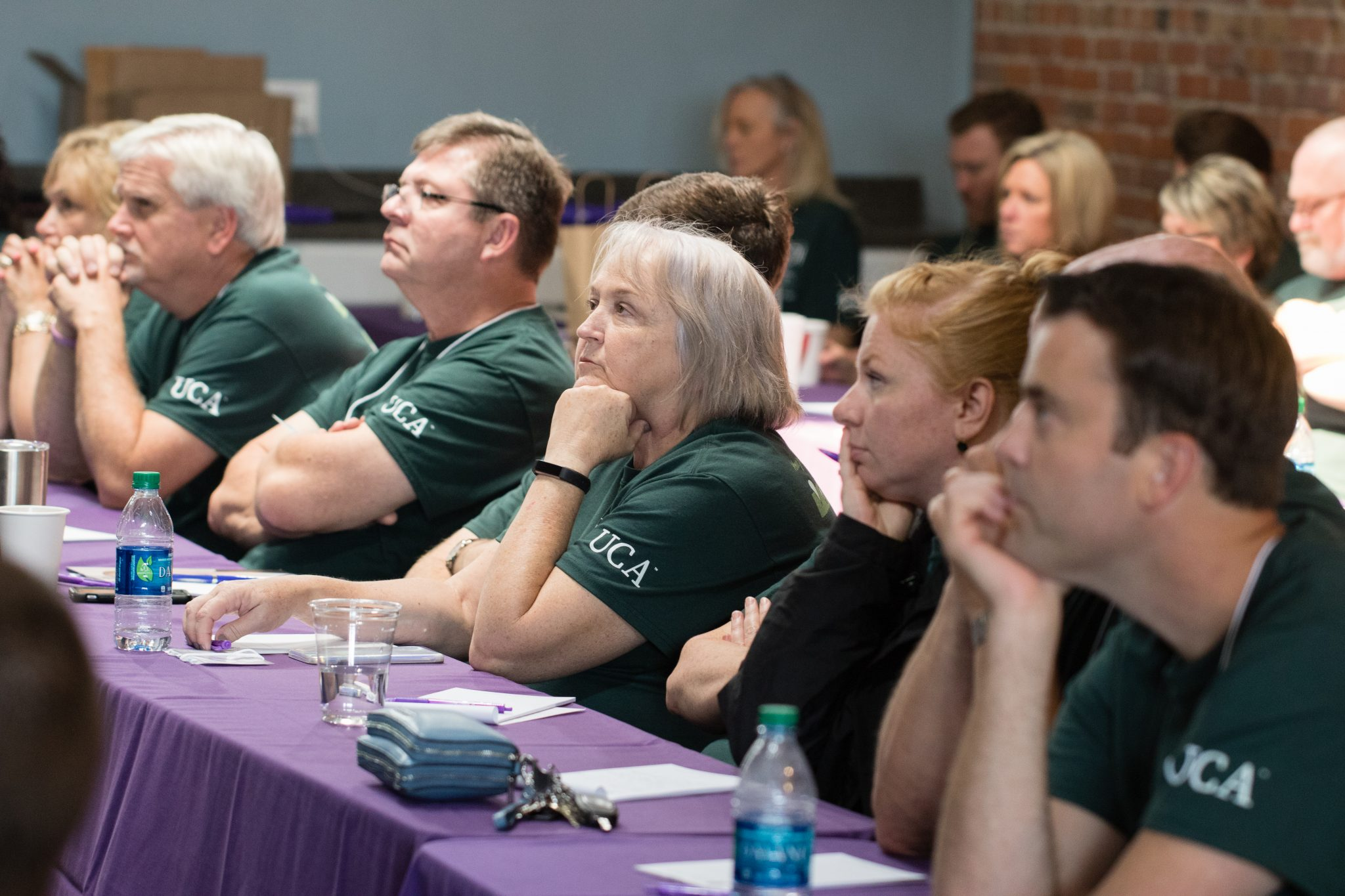 CDI participants engaged in a lecture.