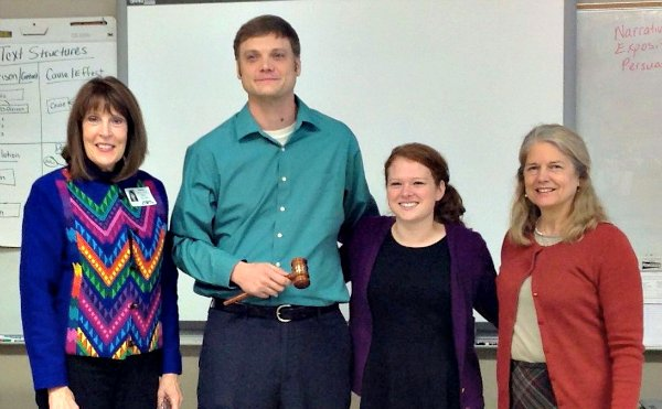 Nancy Gallavan, Emily James, and Mara Cawein present Mr. Jason Campbell with the honor of UCA Mentor Teacher of the Semester.
