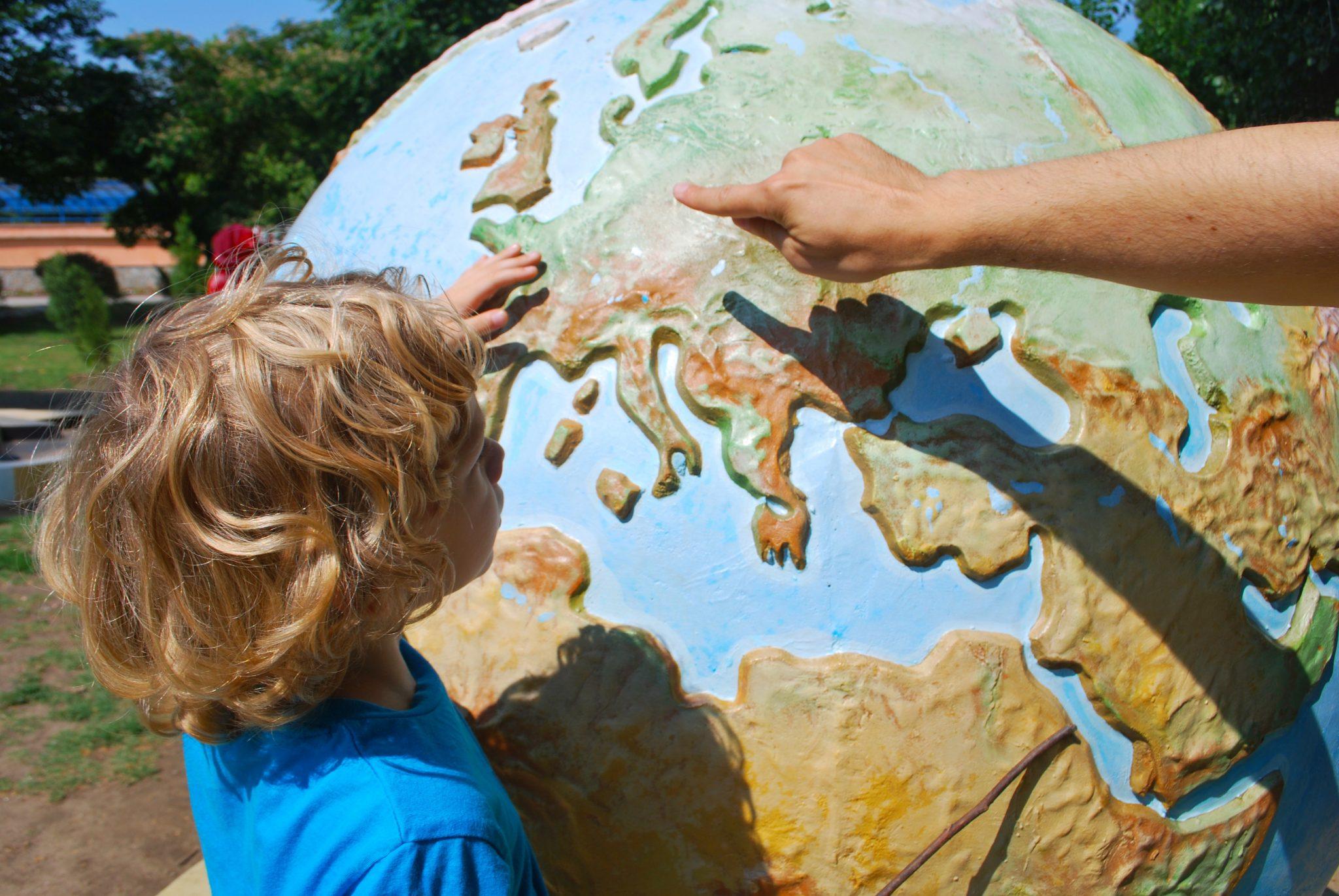 pxhere image child exploring a globe