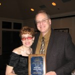 Roger & Barbara Pauly pose with Roger's Outstanding Faculty Award.