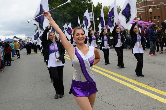 Baton twirler Ciana Diaz performs during the Homecoming Parade.