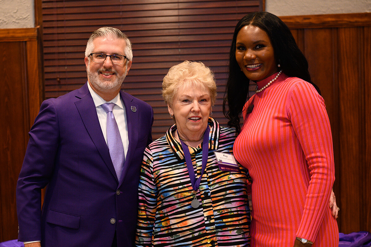 President Houston Davis; Kay Cromwell '69; Rickela Mayo '03
