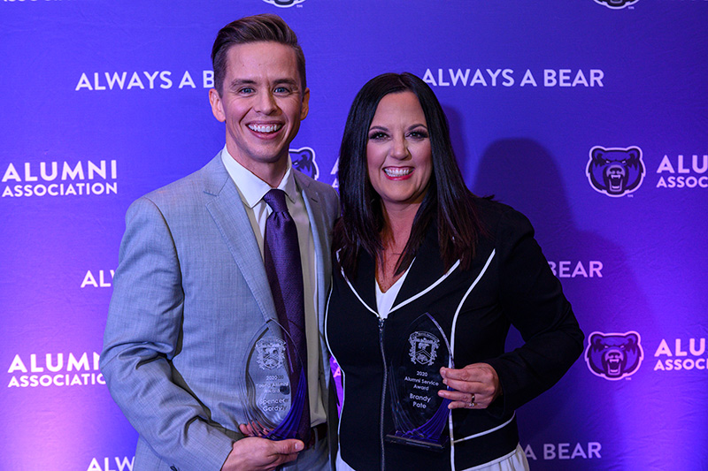 Spencer Gordy '07 and Brandy Pate '98 show the awards they received during the Oct. 25 Alumni and Friends Party. Gordy won the inaugural Young Alumni Award, and Pate was presented with the Alumni Service Award.