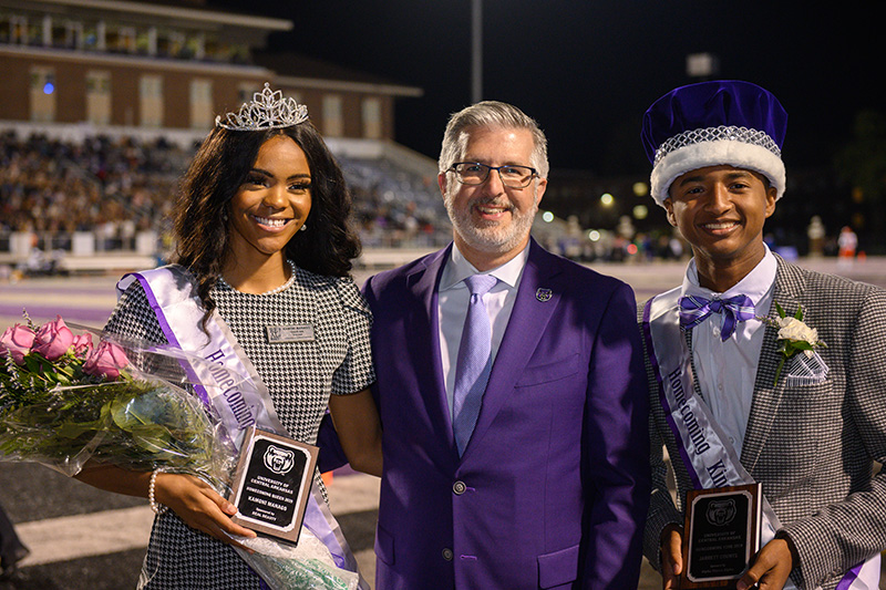 Kamoni Manago, UCA President Houston Davis and Jarrett Counts celebrate the presentation of the 2019 Homecoming Court. Manago was named the 2019 Homecoming Queen, and Counts was named UCA's first-ever Homecoming King.