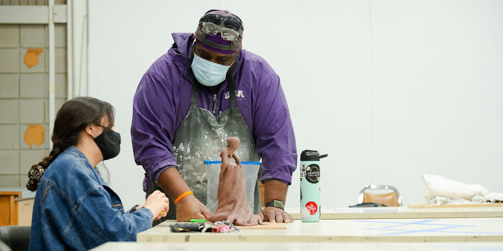 Bryan Massey, professor and chair for the Department of Art and Design, works alongside Charles Johnson, a junior majoring in art education and psychology, on the beginnings of a bronze cast sculpture.