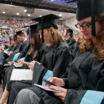 Graduates sending thank you notes with their mobile phones