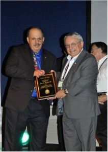 Dr. George Solomon (left) presenting Wilford L. White Fellow Award to Dr. Don B. Bradley