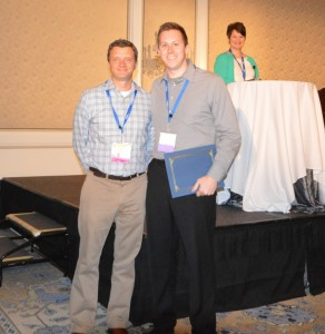 (l to r) Sean Sullivan, general manager of Skyfactor Mapworks, presenting a Mapworks Excellence Award to Thomas Bruick, UCA's campus coordinator for Mapworks