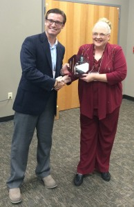 Josh Markham receives the New Professional Award from Terre McClendon, ACDS president