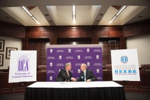 University of Central Arkansas President Tom Courtway and Arkansas State University-Beebe Chancellor Dr. Eugene McKay shake hands after signing the 17th articulation agreement between the two institutions.