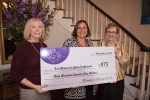 Dr. Ginny Adams (center) being presented a $975 check from UCA First Lady Melissa Courtway and Nan Snow (left to right) on behalf of the UCA Women's Giving Circle.