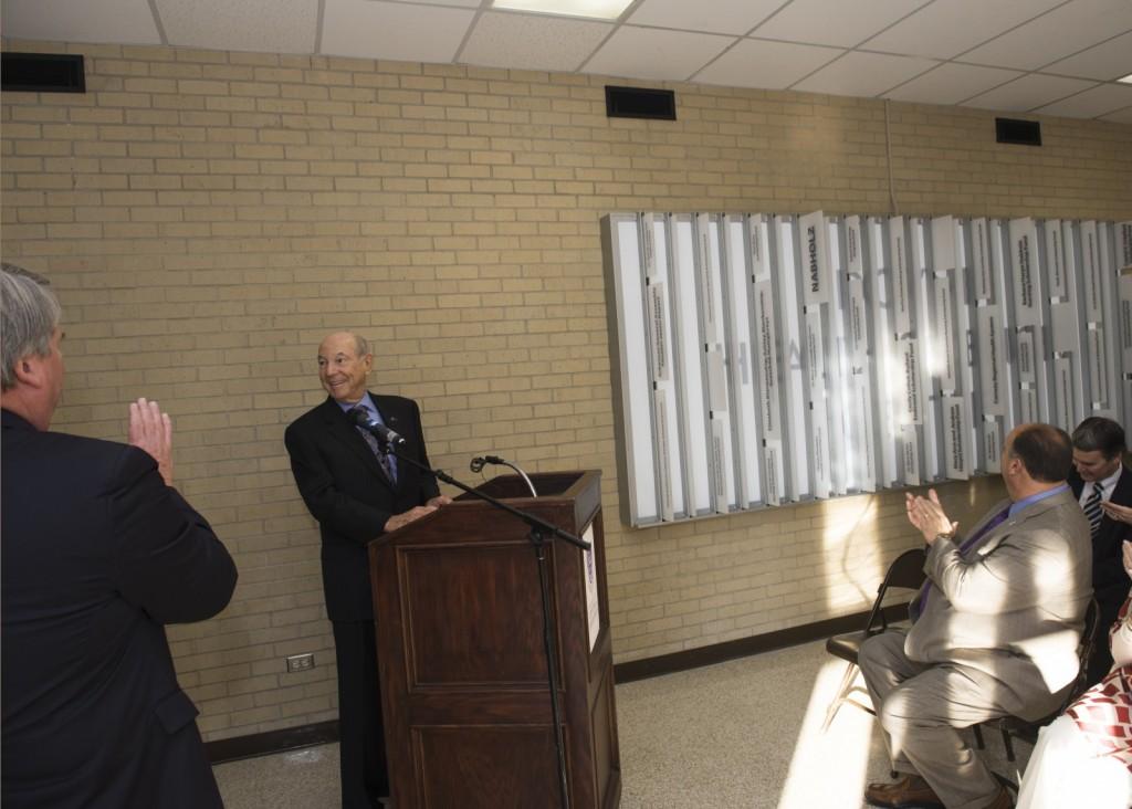 Charles Nabholz, chairman emeritus of Nabholz Corporation, illuminates the donor wall in Doyne Health Sciences Center