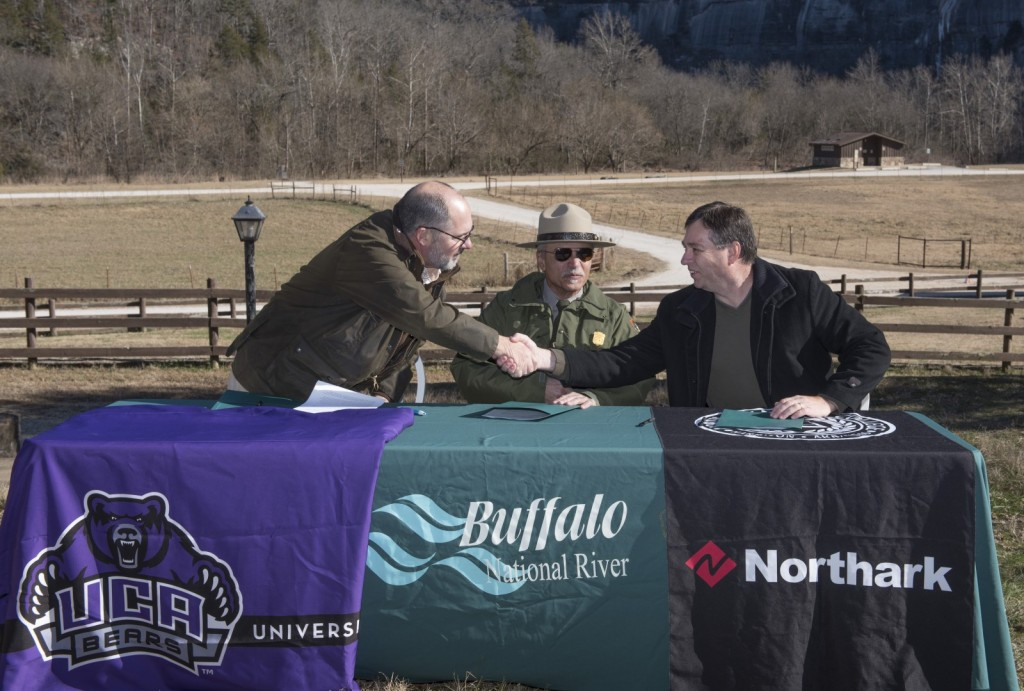 Interim President Kelley Erstine, Kevin Cheri, Buffalo National River superintendent and North Arkansas College President Randy Esters sign partnership agreement.