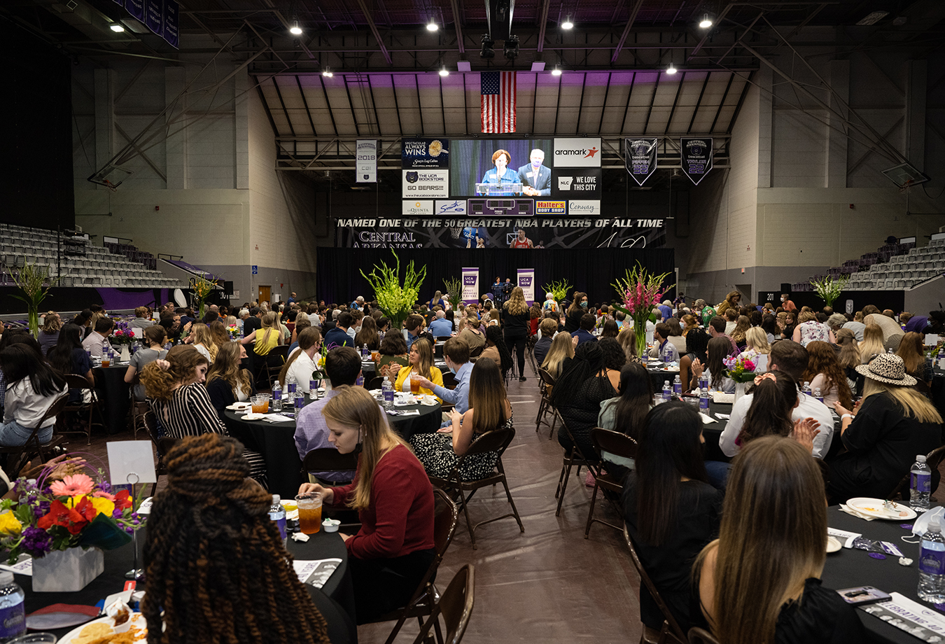 Students and donors sit at tables