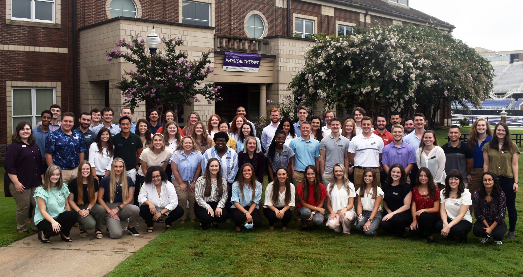Large group photo of class of 2021-2024 outside in front of the PT Center
