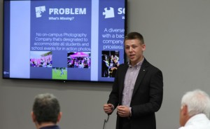 Zach Hull (freshman) pitches his team's business concept to the judges.
